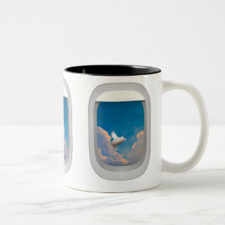 flying pig through airplane windows mug