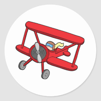 Flying red biplane classic round sticker