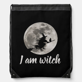Flying witch with a bright moon behind her drawstring bag