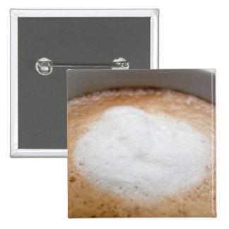 Foam on cappuccino, close-up 15 cm square badge