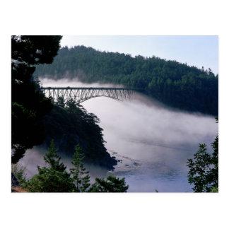 Fog drifts under the Deception Pass bridge at Postcard