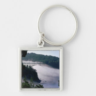 Fog drifts under the Deception Pass bridge at Silver-Colored Square Key Ring