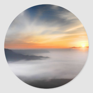 Fog over the mountains of japan during sunrise classic round sticker
