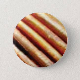 folds of copper 6 cm round badge