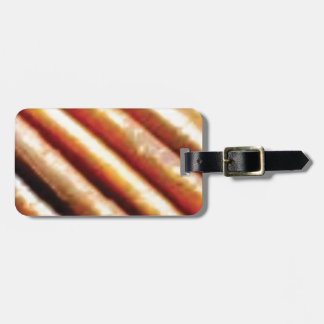 folds of copper luggage tag