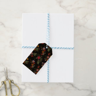 Folk embroidering gift tags