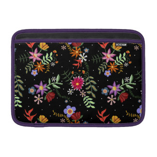 Folk embroidering MacBook sleeve