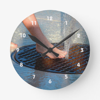 foot in water fountain round clock