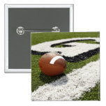 Football at goal line on football field, 15 cm square badge