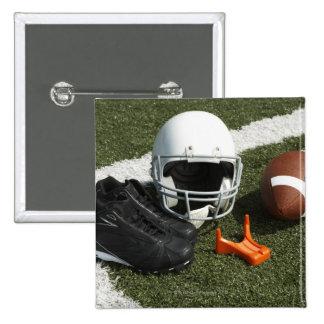 Football football helmet tee and shoes on pins