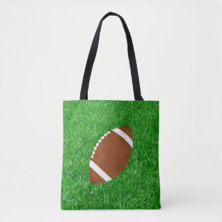 Football On Lawn Tote Bag