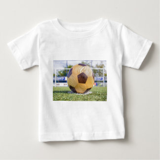 football on penalty spot with goal baby T-Shirt