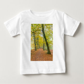 Footpath in forest covered with fallen leaves baby T-Shirt