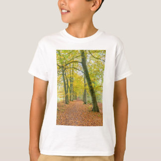 Footpath in forest covered with fallen leaves T-Shirt