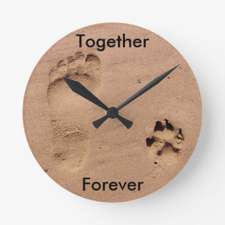 Footprint and Paw Print in Sand Round Clock