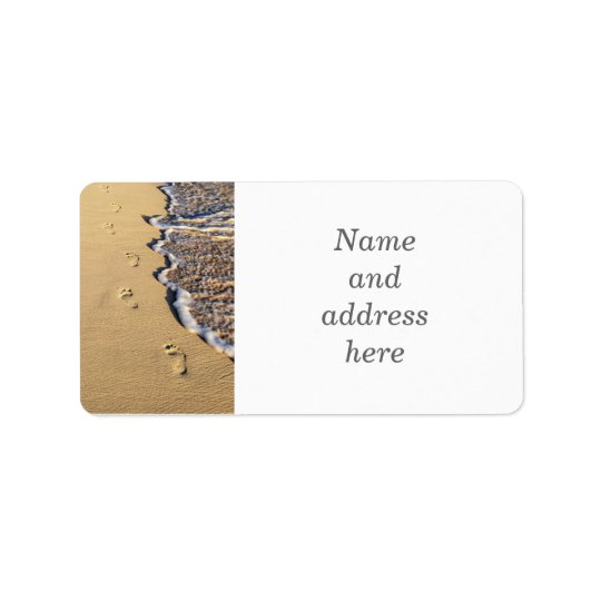 Footprints in sand on beach address label
