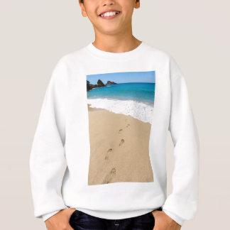 Footsteps in sandy beach leading to blue sea sweatshirt