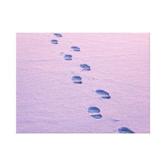 Footsteps on snow canvas print