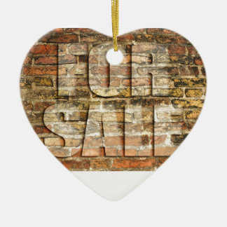 For sale - on ancient brick wall ceramic ornament