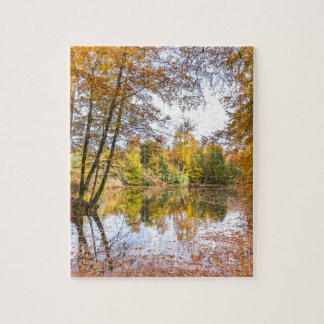 Forest pond covered with leaves in winter season jigsaw puzzle