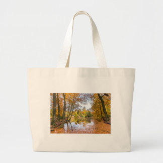 Forest pond covered with leaves in winter season large tote bag