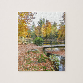 Forest with pond and bridge in fall colours puzzles