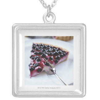 Fork slicing blueberry pie on plate square pendant necklace