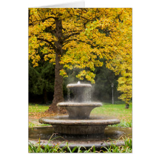 Fountain by a tree in fall, Germany Card