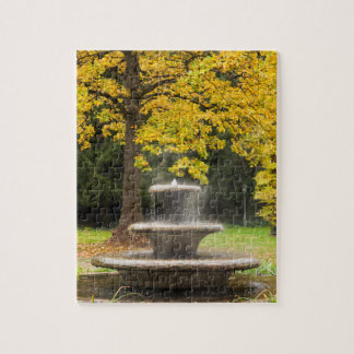 Fountain by a tree in fall, Germany Puzzle