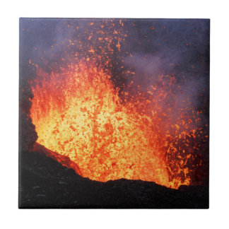 Fountain of hot lava erupts from crater volcano tile