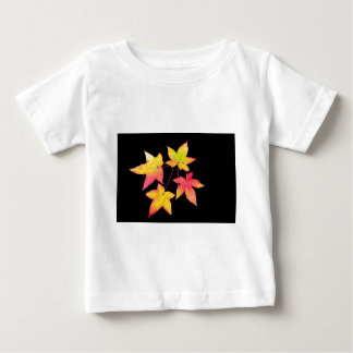 Four colored autumn leaves on black background baby T-Shirt