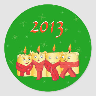 Four golden candles with red scarfs 2013 round stickers