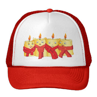 Four golden candles with red scarfs cap
