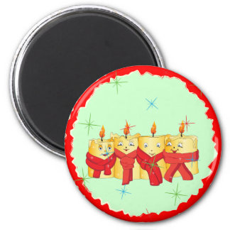 Four golden candles with red scarfs 6 cm round magnet