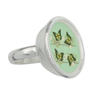 Four green butterflies