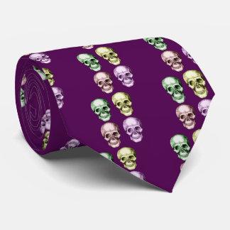 Four human skulls tie