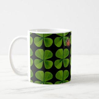 Four-leaf clovers and ladybug - black background coffee mug