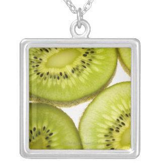 Four pieces of sliced kiwi square pendant necklace