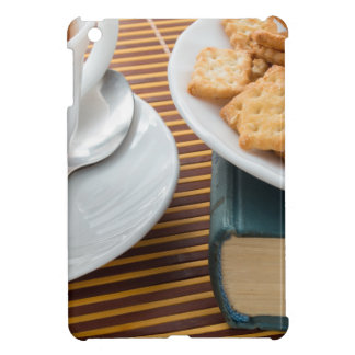 Fragment of a saucer with a cup of tea case for the iPad mini