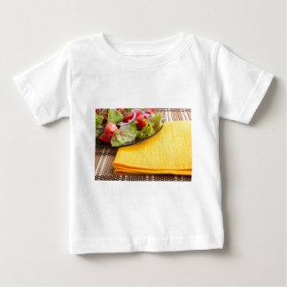 Fragment of a transparent plate closeup with salad baby T-Shirt