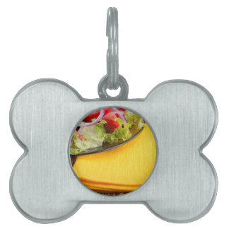 Fragment of a transparent plate closeup with salad pet name tag