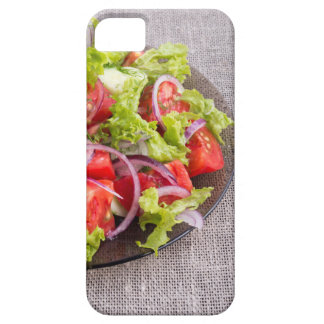 Fragment of a transparent plate with a fresh salad iPhone 5 covers