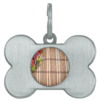 Fragment of transparent plate of fresh vegetarian pet name tags