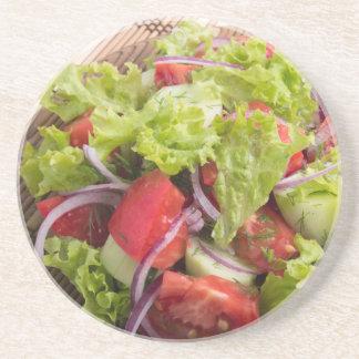 Fragment of vegetarian salad from fresh vegetables sandstone coaster