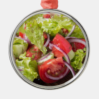 Fragment of vegetarian salad from fresh vegetables Silver-Colored round decoration