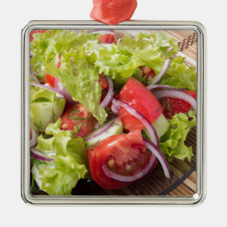 Fragment of vegetarian salad from fresh vegetables Silver-Colored square decoration