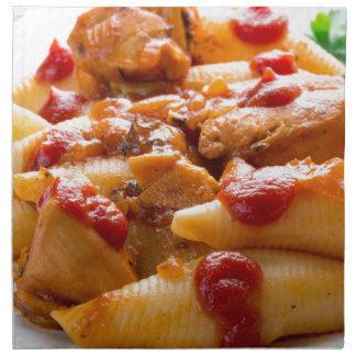 Fragment portion conchiglioni pasta and turkey napkin