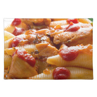 Fragment portion conchiglioni pasta and turkey placemat