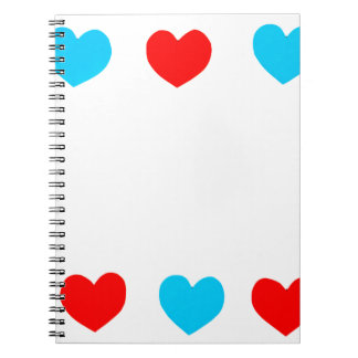 Frame of red and blue paper hearts with copy space spiral note books