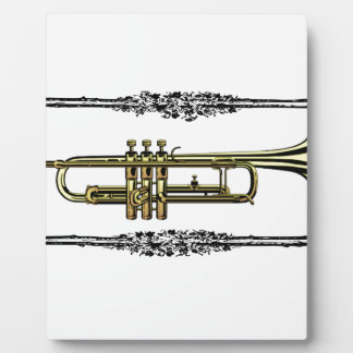 framed trumpet in gold plaques